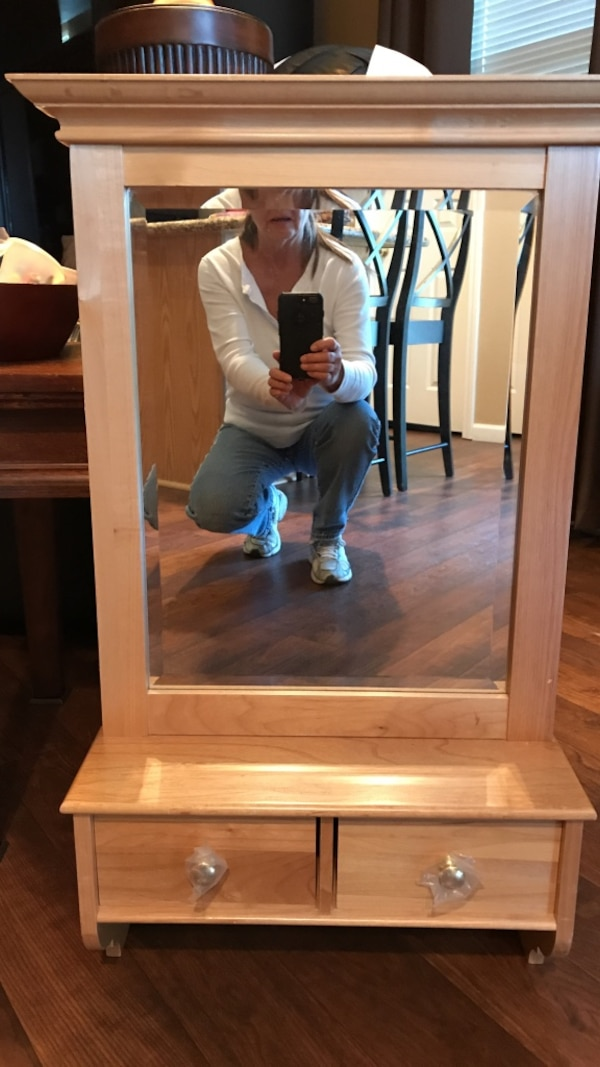 Hanging beveled mirror with drawers. Heavy solid wood. New