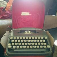 black and gray typewriter with case Findlay, 45840