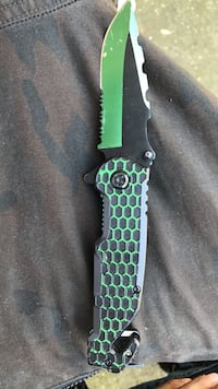 green and black handled folding knife Lansing, 48911