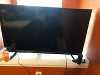 black flat screen TV with remote null