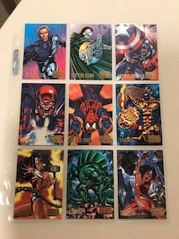 Marvel vs DC assorted card collection. Spider-Man, Superman, Captain America, Thanos, Wonder Woman, X-Men