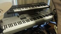 black and silver electric keyboards