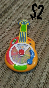 multicolored guitar toy
