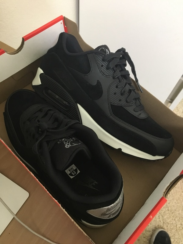 Pair of black-and-white nike airmax shoes with box