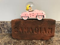 Peanuts Sally Brown car on vintage Canadian brick display. Hamilton, L8H 4R5