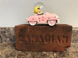 Peanuts Sally Brown car on vintage Canadian brick display.