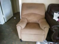brown fabric sofa chair with throw pillow 791 mi