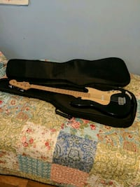 Fender bass guitar and carrying case.