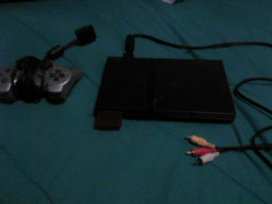 black sony ps2 game console with controller