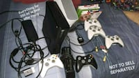 black Xbox 360 with two controllers Hartford, 06105
