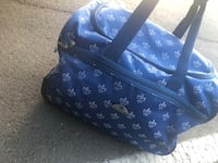Blue and white travel bag with wheels