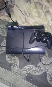 black Sony PS3 Slim with two controllers 229 mi