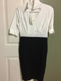 Beautiful never worn white and black dress. This is a medium - large size - white side as a little stain but looks stylish. Negotiable Vaughan, L6A 1K6