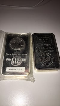Two  five oz silver bars 43 km