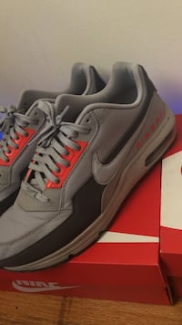 Pair of gray-and-black nike airmax shoes with box size 10