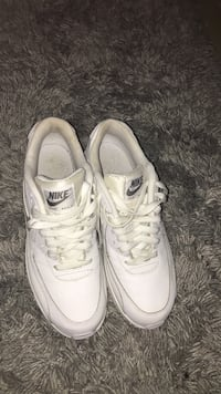 pair of white Nike Air Max shoes