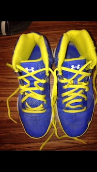 pair of blue-and-yellow Nike basketball shoes 35 km