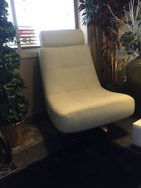 white leather padded rolling armchair Calgary, T3M 0Y3