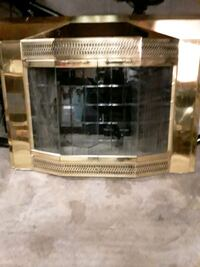 Fireplace cover it's older brass one it's worth$ 309 asking $180