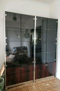 brown wooden framed glass display cabinet Queens, 11432