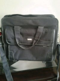 Buxton briefcase on wheels with extendable handle