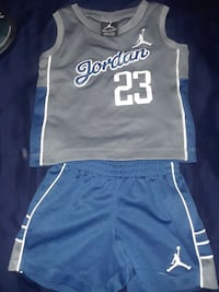 grey and blue Jordan 23 tank top with blue shorts