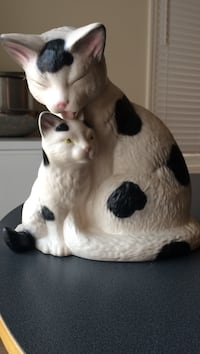 white and black cat with kitten ceramic figurine