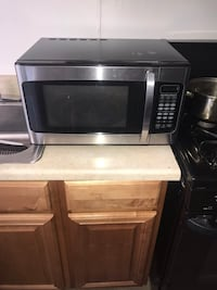 Stainless steel and black microwave Baltimore, 21205