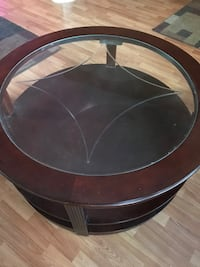 Round glass top coffee table .
