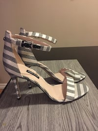 pair of white-and-black wedge sandals Calgary, T2W