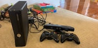 black Xbox 360 with controllers Reston, 20194