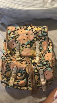 brown and black floral backpack Ames, 50014
