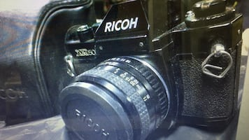 Black ricoh dslr camera