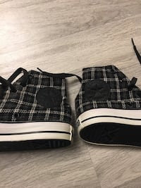 Black and white Converse shoes,