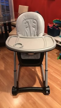 Gray and black high seat with graco play tray Herndon, 20171