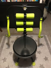 Black and green exercise equipment.AB DOER for whole body exercise.