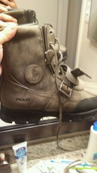 pair of black leather boots Houston, 77065