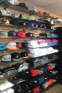 White selection of hats shirts sleeve and half  different prices. Las Vegas, 89145