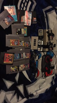 assorted Nintendo game cartridges and controllers New Westminster, V3L 4K7