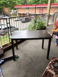 rectangular black wooden table with two chairs Vancouver, V6A 3K2