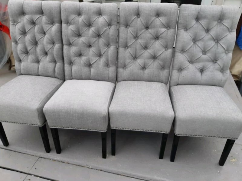 Brand new set of 4 high back tufted dining chairs  fc0de688-e06c-44e7-9f6a-adf096684bf8