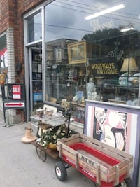 brown wooden framed glass display cabinet Montreal, H8R 1E2