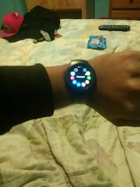 black and blue smart watch