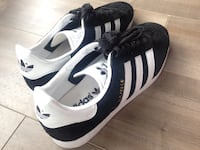 pair of white-and-black Adidas sneakers Vancouver, V6Z 3E1