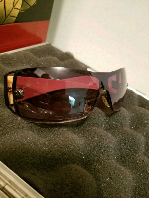 red and black Oakley sports sunglasses