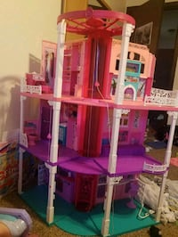 Enormous Barbie Dream House! Opens up for bigger house. Elevator to.