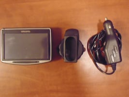 Black TomTom GPS. Charger and Mount Included.