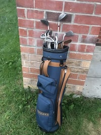 Blue and black golf bag with golf clubs Toronto, M3L 0A1