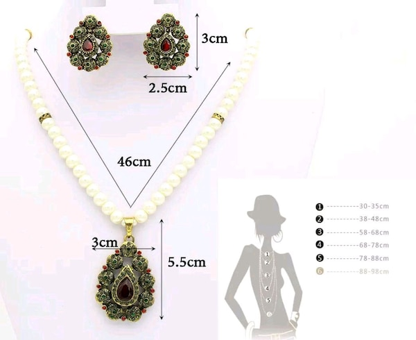 white and green floral pendant necklace