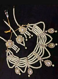 Kundan pearl bridal set necklace earrings .